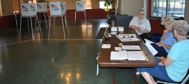 Poll workers at the Union Pacific Depot in North Lawrence count down the final minutes before closing Tuesday afternoon. The depot recorded 138 voters during the day.