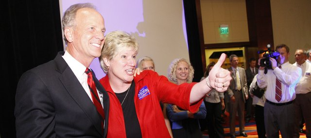 U.S. Rep. Jerry Moran, of Hays, stands next to his wife, Robba, on Tuesday as she gives a thumbs up to his supporters after it was announced that he had won the Republican nomination for the U.S. Senate seat at a watch party organized by the Johnson County Republican Party at the Overland Park Marriott.