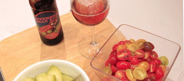 A Copperhead Pale Ale, pickles and heirloom tomatoes are pictured. The Community Mercantile recently held a beer and food pairing demonstration led by chef Rick Martin and brewer Kevin Prescott of Free State Brewing Co.