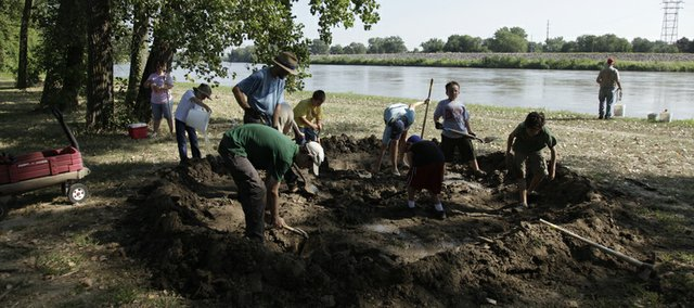 Over 30 volunteers built mud forts on the banks of the Kansas River Tuesday, August 10, 2010. The forts are part of an annual event commemorating Lawrence's role in the Civil War.