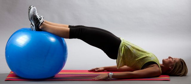 Personal trainer Whitney Samuelson shows the stability ball leg curl in the second position.