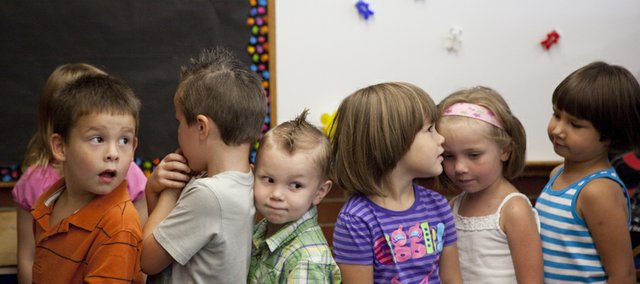 From left, Kennedy preschoolers Kieran Bryant, Levi Cottrell, Mason Fewell, Madison Newman, Hannah Hillebert and Trey Green line up for lunch, Monday, August 16, 2010 at Kennedy School. It was the first day of preschool for approximately 130 students at Kennedy.