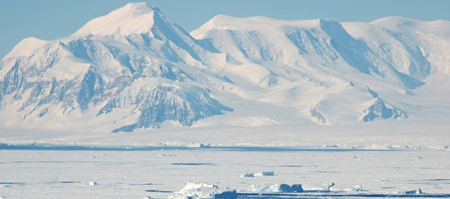 Mountains along the coast of Antarctica release icebergs into the Amundsen Sea during an October 2009 NASA mission which CReSIS engineers took part in to measure changes in polar ice and sea ice.