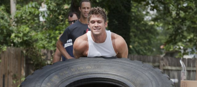 Matt Scanlon flips a 450-pound tractor tire as part of the workout regimen for the Next Level Strongman competition, which will be Sept. 18 in Watson Park. Early registration is due Aug. 27. Visit NextLevelRising.com for more information.