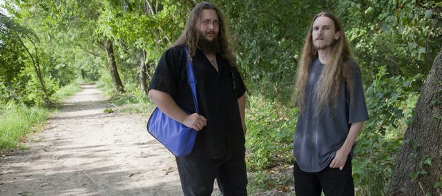 David Tucker, left, and Brad Cook are homeless outreach workers with Bert Nash Community Mental Health Center. Both were preparing to deliver water to homeless campers in August along the Kansas River.