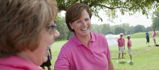 Kansas University women's basketball coach Bonnie Henrickson, right, visits with Mary Snyder of Kansas City, Mo., before the start of the sixth-annual Bonnie Henrickson golf tournament. Roughly 300 golfers participated in the charity event — with proceeds going to breast cancer research via the KU Breast Center and Lawrence Memorial Hospital — on Saturday at Alvamar.