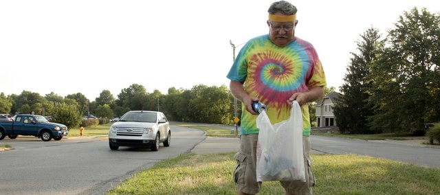 Alan Welles started walking on Princeton Boulevard in northwest Lawrence to lose weight, but he soon grew bored. Welles now picks up trash every day during his two and a half hour walk on the boulevard from Iowa Street to Lawrence Avenue.