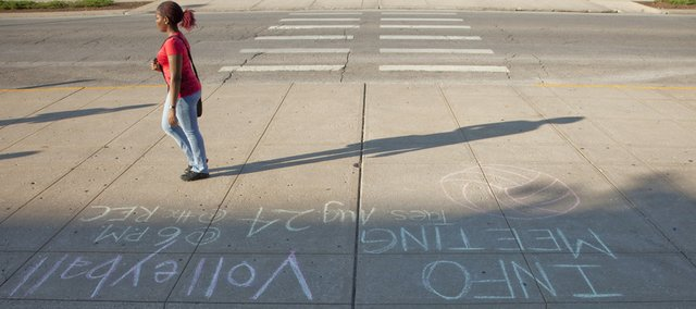Kansas University has a new chalking policy that makes it so outside groups can't use sidewalk chalk to advertise on campus without permission, thus shutting out bars posting notice of drink specials, among other businesses.