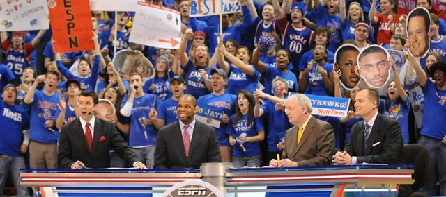 Kansas fans go wild as members of the ESPN College GameDay crew Rece Davis, left, Hubert Davis, Digger Phelps and Jay Bilas go live from James Naismith Court at Allen Fieldhouse. Students were allowed to enter around 8 a.m.