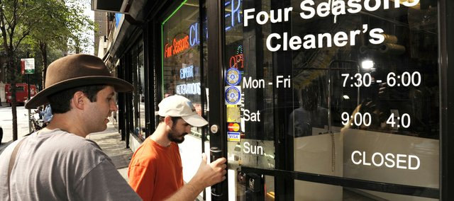 Jeff Deck, 30, holds the door for Benjamin Herson, 30, two word nerds and earnest agents of TEAL — Typo Eradication Advancement League — as they enter a dry cleaning establishment on 19th Street in Philadelphia, to ask if they can remove the erroneous apostrophe in the name. The name of the dry cleaners should read Four Seasons Cleaners.