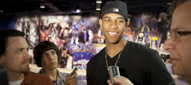 Former Kansas University guard Xavier Henry talks with media members Wednesday in Allen Fieldhouse. Henry, who was taken as the No. 12 pick by the Memphis Grizzlies in the NBA Draft, is in town working out with former teammates while waiting for an agreement on his pro contract.