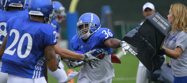 Kansas running back Deshaun Sands breaks through during practice Tuesday, Aug. 17, 2010. Sands is among several running backs competing for playing time.