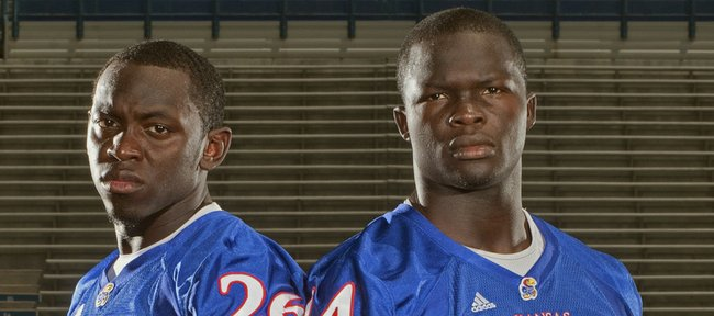 Phillip Strozier, left, and  Olaitan Oguntodu are two of the most experienced members of Kansas University's safety corps, which still bears the imprint of departed Darrell Stuckey.