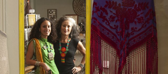 Alia Sachedina, left, took over the boutique shop Adorned, 5 E. Seventh St., her mother, Elizabeth Kurata, started 25 years ago. It used to be called African Adorned, one of the changes Sachedina has made.