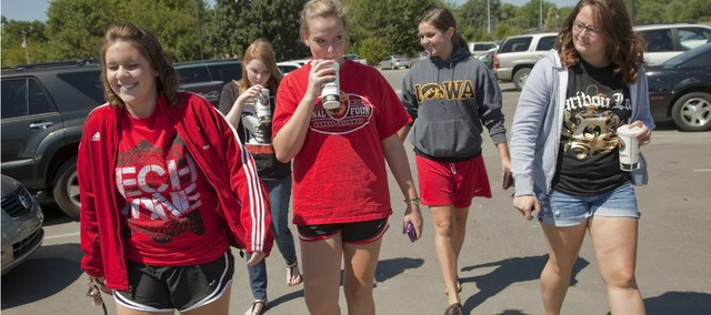 A group of Lawrence High school seniors returns to school after picking up a meal to go at Jimmy John's on Friday. From left are Sydney Alexander, McKayla Murphy, Brandi Bradfield, Sami Johnson and Emily Fritschen. Lawrence school board members say they're willing to close high school campuses for lunch, at least for freshmen and sophomores and possibly for juniors and seniors, to improve students' safety.