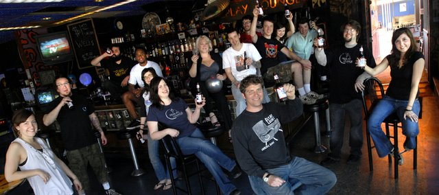 Cheers to the Replay Lounge and owner Nick Carroll, front and center, pictured with staff members of the bar in this 2007 file photo. The bar was voted one of the best bars in America in a recent Complex Magazine article.