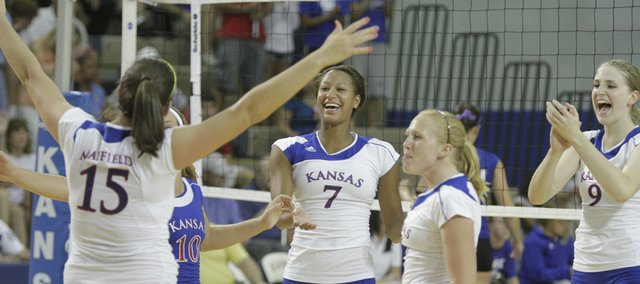 Kansas players, from front left, Allison Mayfield, Brianne Riley, Karina Garlington, Morgan Boub and Caroline Jarmoc celebrate a win in the first set against UMKC on Tuesday at the Horejsi Center.