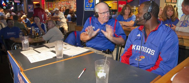 Diners at Buffalo Wild Wings Bar and Grill, 1012 Mass., were treated to a live Hawk Talk radio show with Kansas University head football coach Turner Gill, right, and announcer Bob Davis on Thursday. The event was part of a pep rally in downtown Lawrence hosted by Kansas Athletics, the Lawrence Chamber of Commerce and Downtown Lawrence Inc.