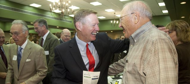 "Ford CEO and Lawrence native Alan Mulally greets friend Frank Becker, a Lawrence businessman, former regent of the Kansas Board of Regents and current advisory board member for KU's School of Engineering, after the Community Education Breakfast Friday at the Lawrence Holidome, 200 McDonald Drive. Mulally served as the keynote speaker for the sold-out event, which benefits the Lawrence Schools Foundation. ""I've know Alan for a long long time and he's a wonderful young man,"" Becker said."