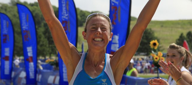 Chrissy Wellington celebrates after winning the women's division of Sunday's Ironman 70.3 Kansas.