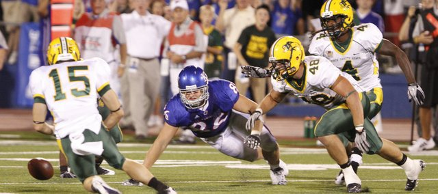 The North Dakota State defense scrambles to recover a fumble by Kansas tight end Tim Biere late in the fourth quarter, Saturday, Sept. 4, 2010 at Kivisto Field. The fumble was Biere's second of the game.