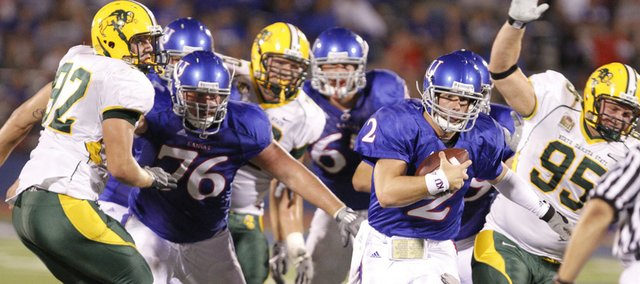 Kansas quarterback Jordan Webb takes off on a run against the North Dakota State defense during the fourth quarter, Saturday, Sept. 4, 2010 at Kivisto Field. The Jayhawks came up short in their season opener, dropping the contest 6-3.