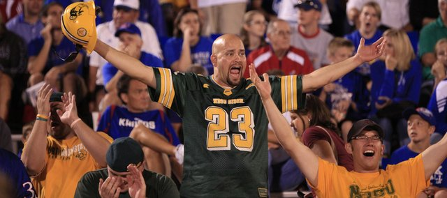 A handful of North Dakota State fans celebrate against a backdrop of Kansas fans as time dwindles late in the fourth quarter, Saturday, Sept. 4, 2010 at Kivisto Field. The Jayhawks dropped their home opener 6-3.