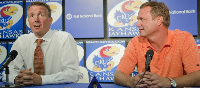 Sean Lester, left, an associate athletics director, is introduced as the interim athletics director Tuesday at KU. KU men's basketball coach Bill Self also attended the press conference with Lester. In a statement on the Kansas University website Tuesday, Chancellor Bernadette Gray-Little and Athletic Director Lew Perkins announced that Perkins will retire, effective immediately.