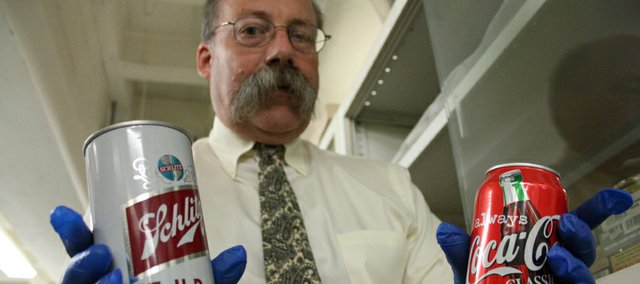 "A Schlitz ""Tall Boy"" can from the 1960s, dug from Smithsonian storage by Peter Liebhold, dwarfs a modern can of Coca-Cola. Wednesday is the 200th birthday of the humble can, which revolutionized the way we eat."