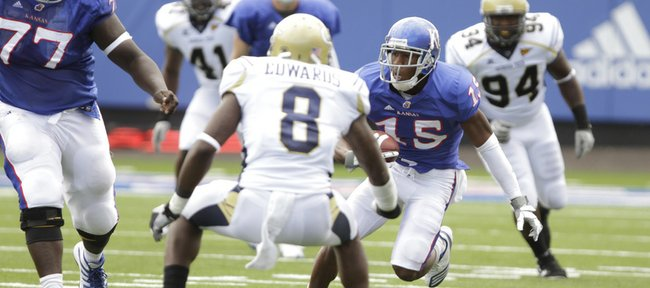 Kansas receiver Daymond Patterson makes a move against the Georgia Tech defense during the first quarter, Saturday, Sept. 11, 2010 at Kivisto Field.