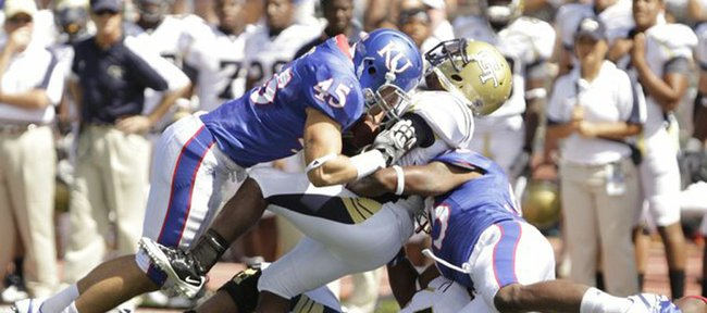 Kansas linebacker Justin Springer (45) takes Georgia Tech quarterback Joshua Nesbitt off his feet with a hard hit during the second quarter, Saturday, Sept. 11, 2010 at Kivisto Field.