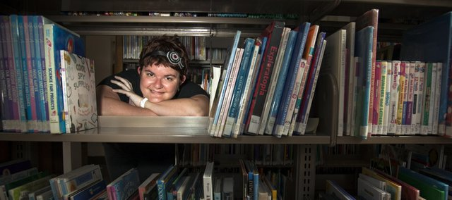 Kim Fletcher is youth services coordinator at the Lawrence Public Library, 707 Vt.
