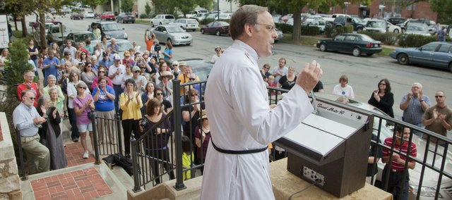 "The Rev. Peter Luckey, senior pastor at Plymouth Congregational Church, addresses a crowd gathered at the church, 925 Vt., for a service, ""Interfaith Solidarity in the Wake of 9/11,"" outside the church Saturday. The service was organized in response to a Florida minister's threat to burn the Quran and featured speakers representing Christian, Islam and Jewish faiths."