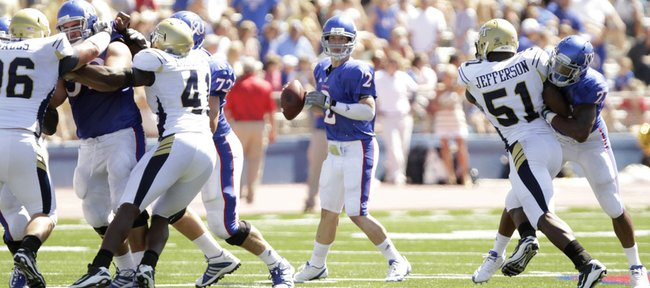 Kansas University quarterback Jordan Webb looks for a target against Georgia Tech as he gets pass protection during the fourth quarter on Saturday at Memorial Stadium. The Jayhawks have been operating effectively out of the shotgun formation with Webb at the helm.