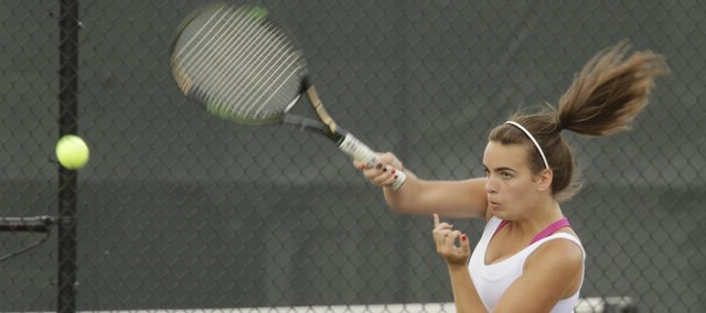 Abby Gillam prepares to return a volley in her doubles team match against Topeka High.