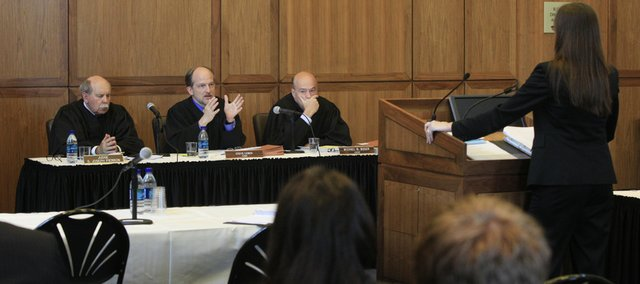 A three-judge panel of the Kansas Court of Appeals consisting of, from left, judges G. Joseph Pierron Jr., Steve Leben and Michael B. Buser listened to Kansas City, Mo., attorney Kristi Hartmann debate the first of three cases at Kansas University's Dole Institute of Politics as part of the university's Constitution Day activities.