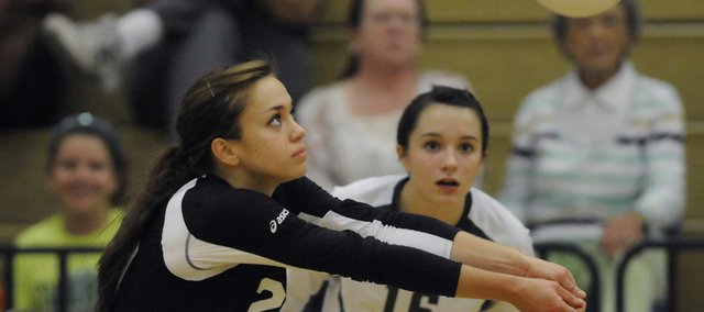Free State senior Reilly Moore bumps the ball against Shawnee Mission Northwest on Thursday at Free State High.