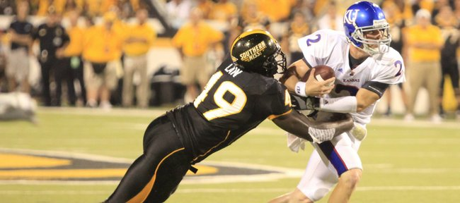 Kansas quarterback Jordan Webb is sacked by Southern Miss defensive lineman Cordarro Law during the third quarter, Friday, Sept. 17, 2010 at M.M. Roberts Stadium in Hattiesburg, Mississippi. The Jayhawks fell to the Golden Eagles 31-16.