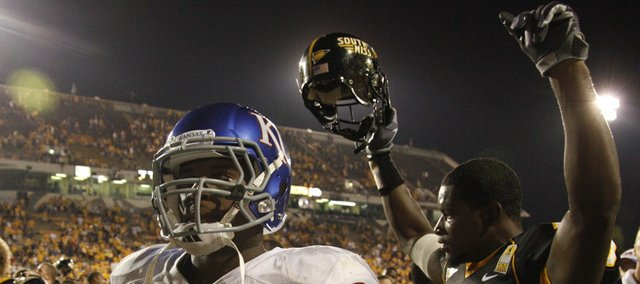 Kansas running back James Sims walks off the field as Southern Miss defensive back Chico Hunter raises his arms in victory following the Jayhawks 31-16 loss to the Golden Eagles, Friday, Sept. 17, 2010 at M.M. Roberts Stadium in Hattiesburg, Mississippi.