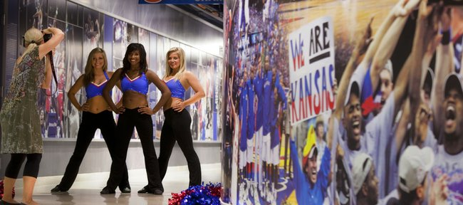 Rock Chalk Dancers, from left, Molly Ryan, Jade Daniels and Brooke Ryan pose Wednesday during a shoot for the Rock Chalk Dancers calendar with photographer Tamalee Baker in the west hallway of Allen Fieldhouse on Sept. 15, 2010.