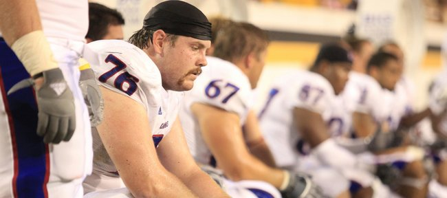 Kansas offensive lineman Brad Thorson sits on a quiet KU bench during the third quarter, Friday, Sept. 17, 2010 at M.M. Roberts Stadium in Hattiesburg, Mississippi.