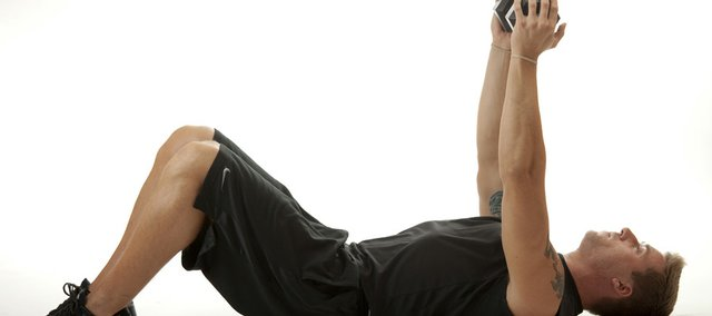 The skull crusher: Lie on the floor or a bench. Hold a dumbbell with both hands straight over your chest