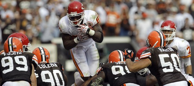 Kansas City Chiefs running back Thomas Jones leaps over the Cleveland defensive line on fourth down late in the fourth quarter. Jones earned a crucial first down on the play, and the Chiefs were able to hold on for a 16-14 victory over the Browns on Sunday in Cleveland.