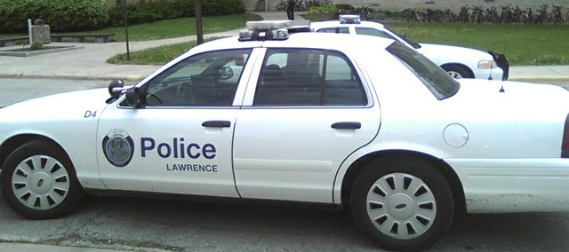 In this 2010 file photo, a Lawrence Police Department vehicle is parked outside McCollum Hall.