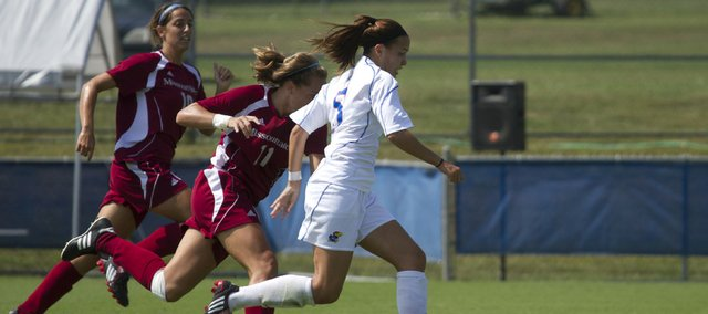 KU's Kortney Clifton (5) runs past two Missouri State defenders on her way to scoring an unassisted goal during the first half of the Jayhawk's soccer match against the Bears Sunday afternoon.