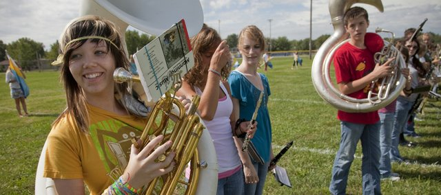 Amber Aylor, a Perry-Lecompton high school junior and marching band member, left, rehearses formations with the band on Tuesday. The Marching Jayhawks and the University of Kansas School of Music will host Perry-Lecompton and over 30 other high school marching bands for the 63rd annual Band Day on Saturday, Sept. 25.