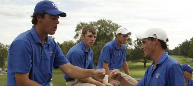 Nate Barbee, right, gets a fist bump from teammate Doug Quinones after the final round of the Kansas Invitational. The Jayhawks finished sixth on Tuesday at Alvamar.