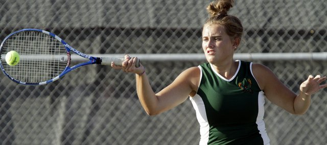 Free State High senior Kelly Phipps smacks a return. Phipps and teammate Alexis Czapinski went undefeated in a quad Wednesday at FSHS.