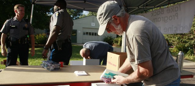 Lawrence resident Jeff Joseph was one of many who dropped off old prescription drugs at the Douglas County Fairgrounds on Saturday, Sept. 25, 2010, for Take-Back Day.