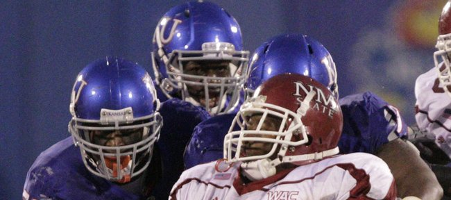 The Kansas defense line stops NMSU running back Seth Smith in the first half Saturday, Sept. 25, 2010 at Kivisto Field.